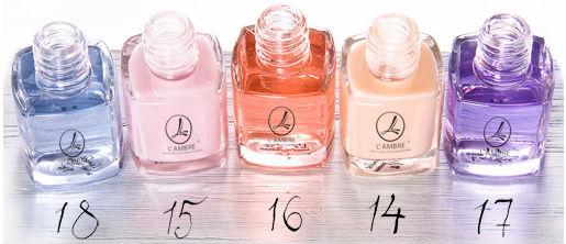 Флаконы средств ухоженные ногти серии средств для ухода за ногтями парфюмерно-косметической компании Ламбре (Lambre)